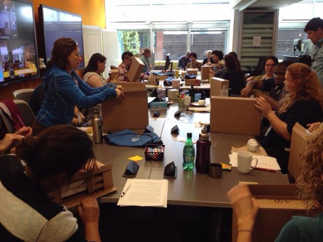 Ascend participants unbox their laptops