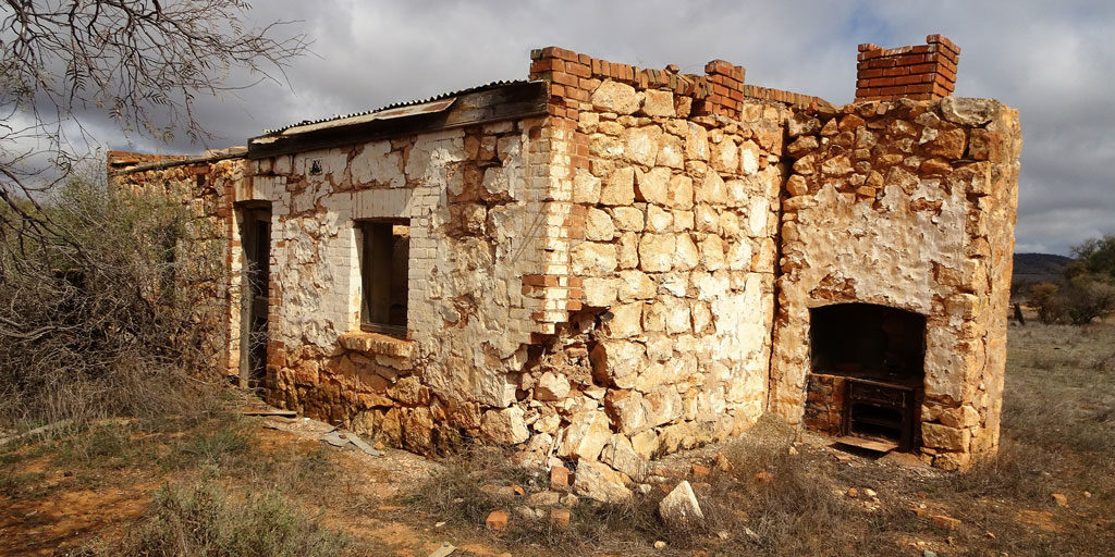 Photo of a cottage with a crumbling foundation